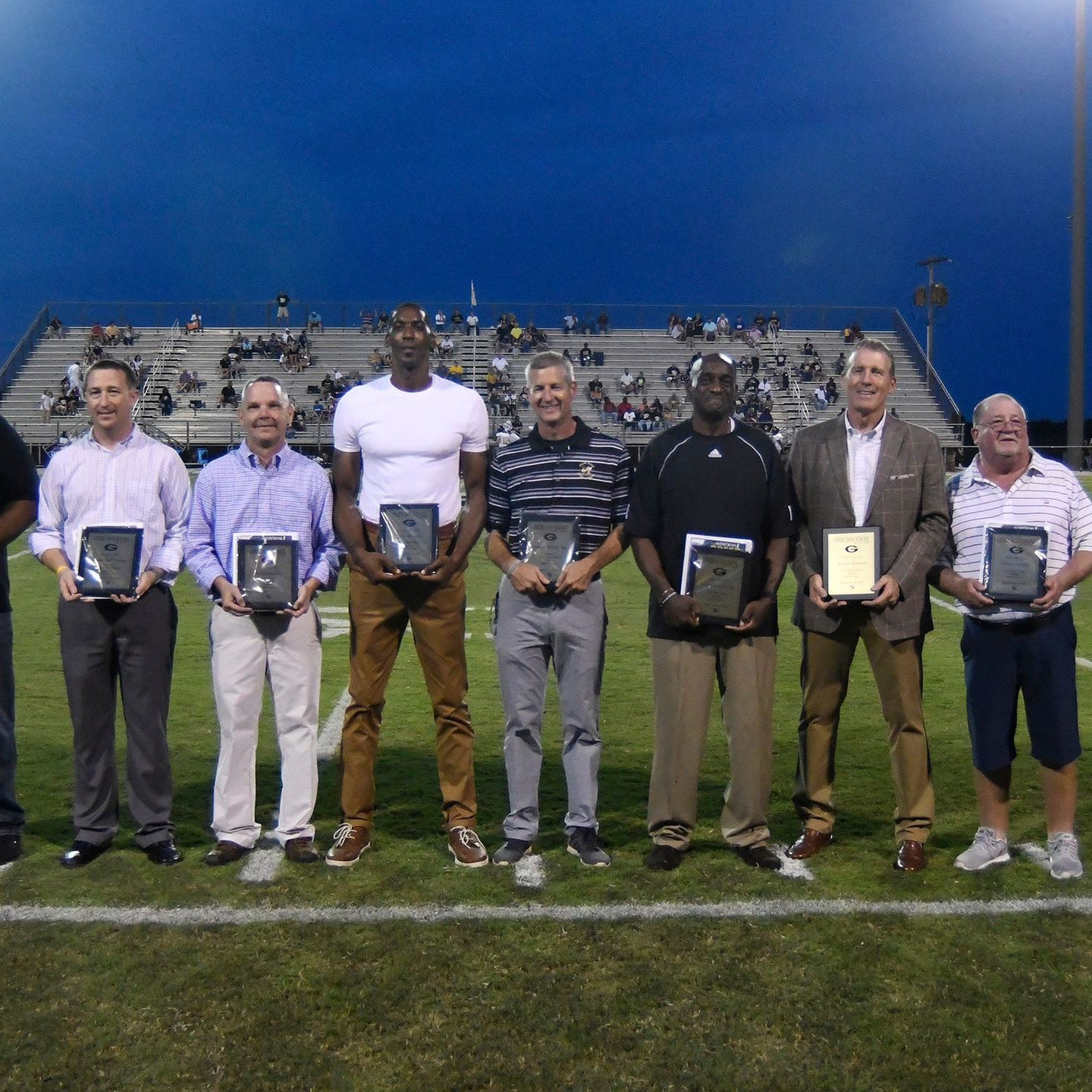 "The seven newest members of the Greer High School Athletic Hall of Fame are, from left, Ty Gregory, Brian ""Red"" Watson, David Holtzclaw, Kris Bruton, Steven ""Worm"" Gay, Anthony Jones, Ralph Polson and Mike Gravley."