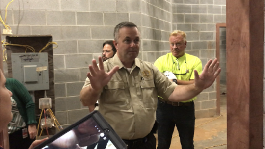 Pickens County Sheriff Rick Clark gives members of County Council a tour of the new county jail under construction.