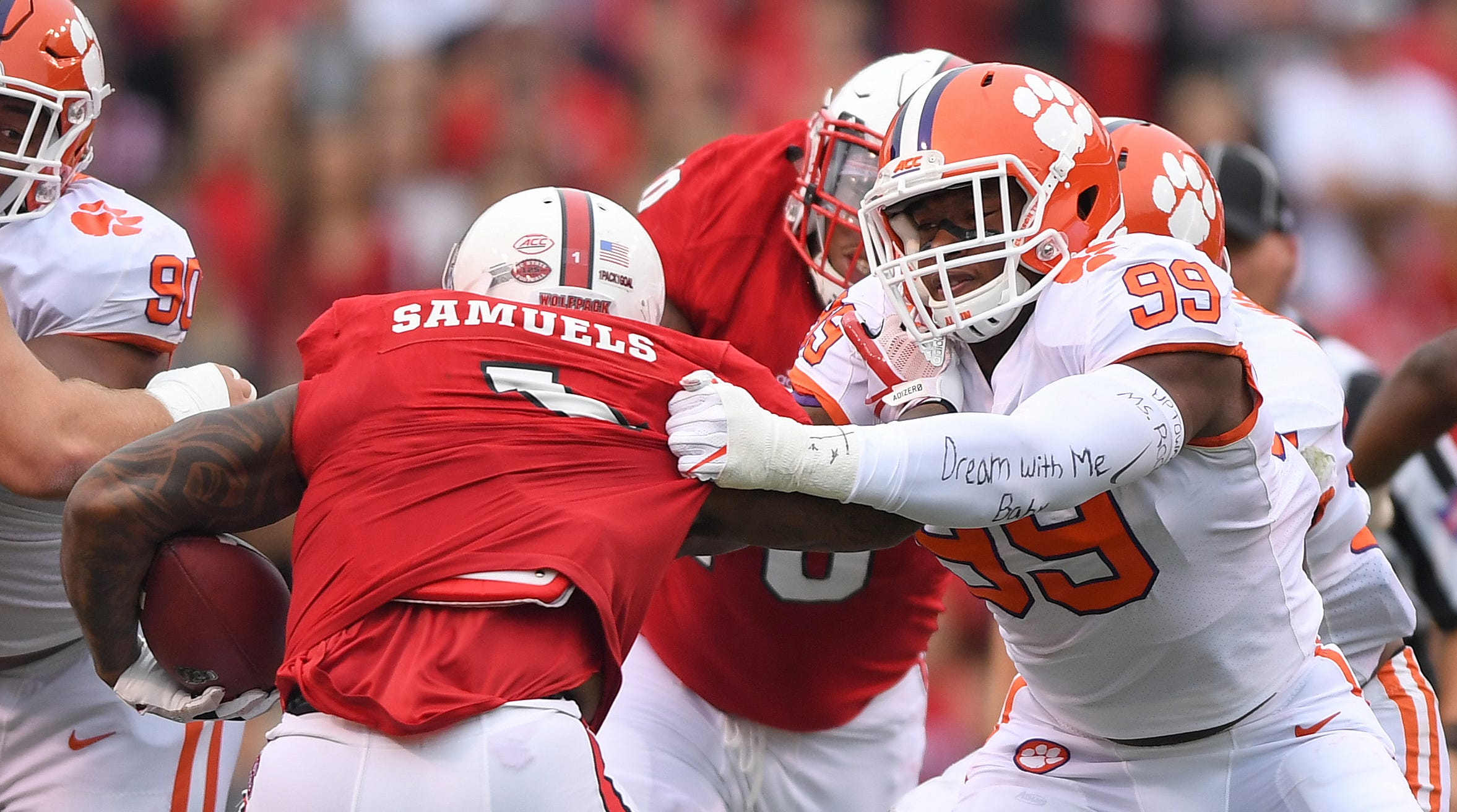Clemson defensive lineman Clelin Ferrell (99) wraps up NC State's Jaylen Samuels (1) during the 1st quarter on Saturday, November 4, 2017 at N.C. State's Carter Finley Stadium in Raleigh, N.C.