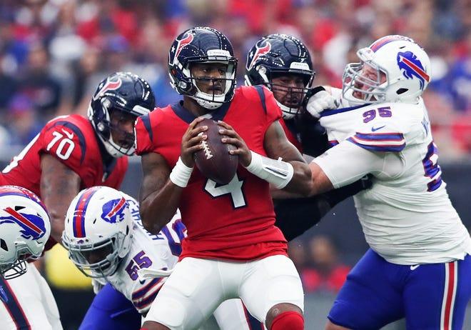 Houston Texans quarterback Deshaun Watson (4) throws during the first quarter against the Buffalo Bills at NRG Stadium.