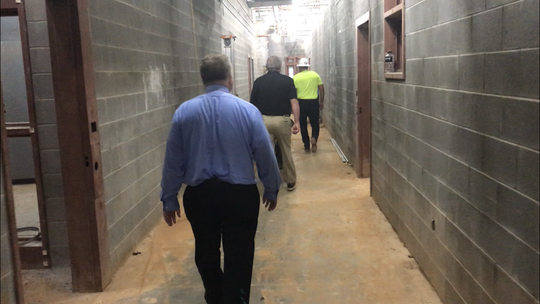 Members of Pickens County Council tour the new county jail under construction.