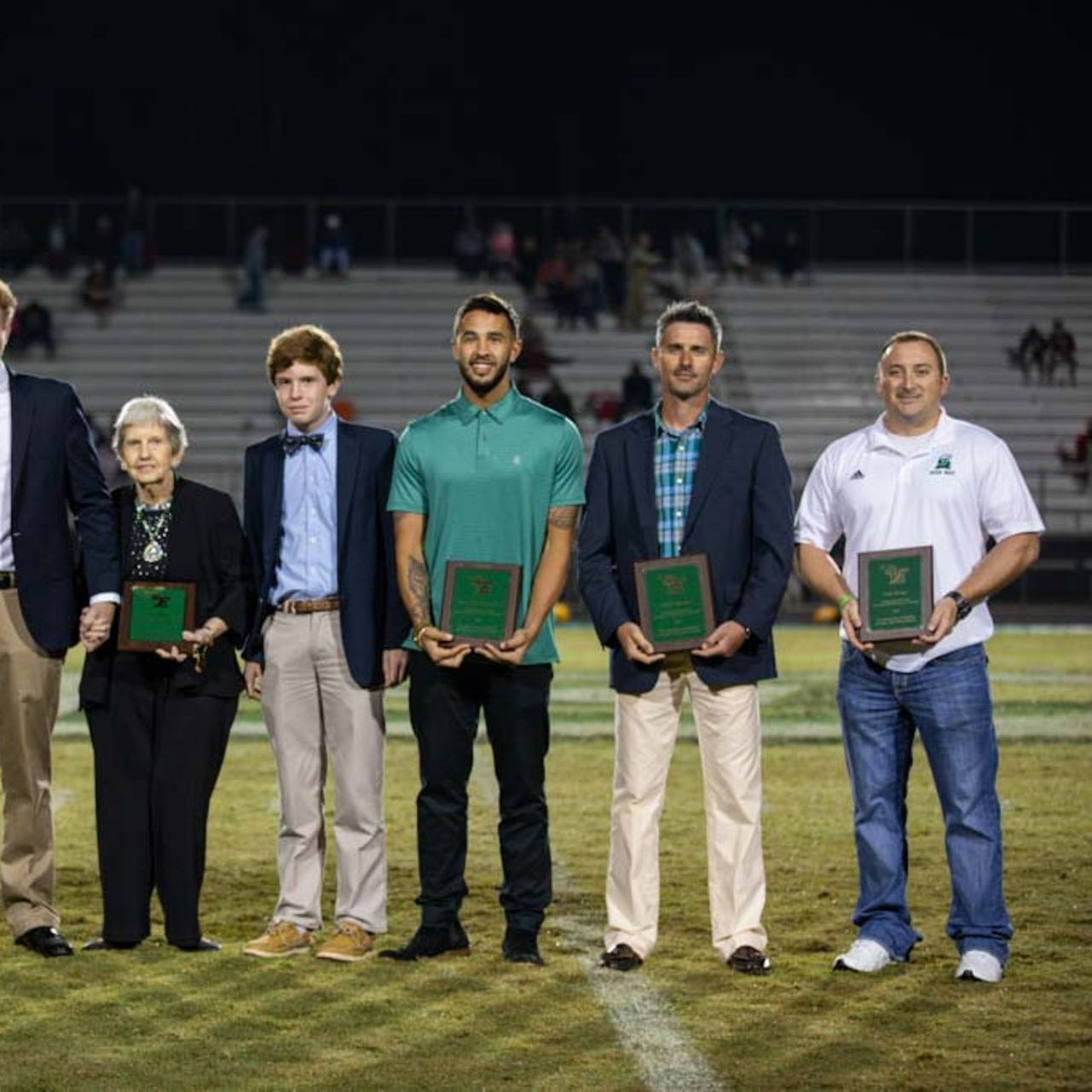 Honored during Easley High School's 2018 Hall of Fame induction were, from left, Sammy Galloway, Sam Houston, Ann King (wife of inductee Gary King, who was joined by their grandchildren), Troy McGowens II, Zach Reeves and Colt Shope.