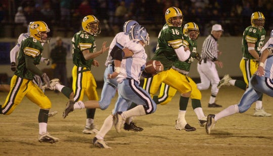 -  Great Falls High running back Rob Schulte runs to daylight against CMR in 2002.