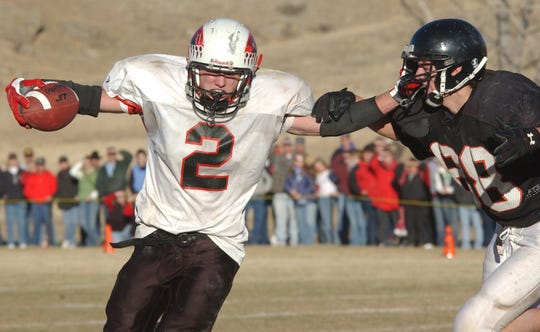 Stanford running back Caleb Gee runs with the football against Centerville in the 2002 State C playoffs.