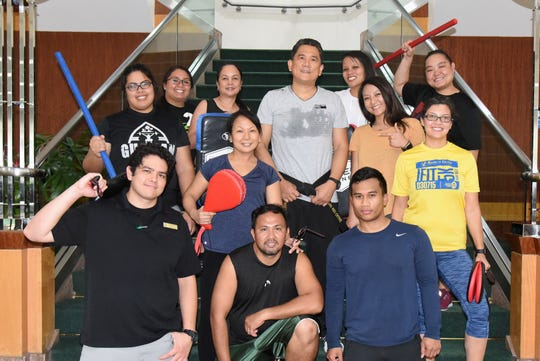 Master Noly Caluag, chief instructor of Guam Taekwondo Center, Inc. offered a free Taekwondo Self-Defense and Fitness Class to Bank of Guam employees at their head office Oct. 11.  Employees were taught basic hand strikes, blocks and kicks, and practical self-defense. Pictured in the first row: Devin Franquez, Rex Gabalunos , Joaquin Arriola Bellis; second row - Brittney Pereda, Loreta Gabalunos, Master Noly Caluag, Raelene Alicto, Clarissa D. Cruz; third row - Chelsey Ting, Myra Borja, Rebekah Cepeda and Julie Borja.