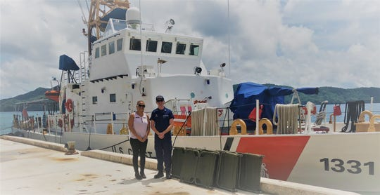 Jennifer Anson, Palau's Ministry of Justice Anti-Human Trafficking office coordinator, receives cots from Lt. Grant Rutter, commanding officer, U.S. Coast Guard Cutter Washington in Koror, Palau Oct. 2. The cots were donated by Joint Region Marianas in Guam and delivered by the U.S. Coast Guard Cutter Washington crew.