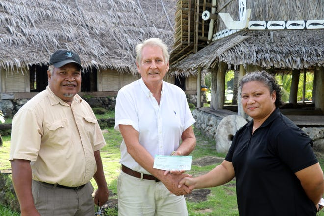 The Yap Living History Museum in the heart of Colonia, the island's center of commerce and government, has received a generous donation from a group of Bank of Guam employees. Jamie P. Gilmar (right), Bank of Guam operations manager in Yap, Don Evans (center), chairman of the Board, Yap Living History Museum, Tom Tamangmow (left), YVB project development manager, in front of the Museum's traditional buildings.