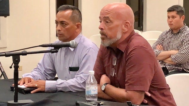 """Attorney Tom Fisher, right, on Tuesday night says the Guam Election Commission seems to """"hide behind procedural shield"""" for not immediately taking up his Oct. 10 letter asking whether Bank of Guam President Lou Leon Guerrero can maintain a vast interest in the bank and still be in charge of the government's funds deposited in her bank if she wins the gubernatorial race. Sen. Frank Aguon Jr., left, also awaits GEC's decision on his letter on write-in gubernatorial candidacy."""