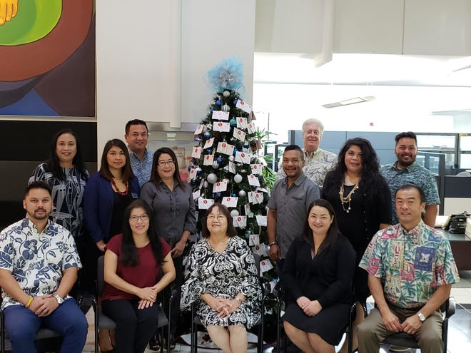Bank of Hawaii continues its partnership with Sugar Plum Tree for their 2018 launch in Hagåtña on Oct. 15, 2018. Sitting from left: Vince Perez, Erlinda Alegre, Barbara Leon Guerrero, SPT director, Rachalyn Cardines and Mark Tokito. Standing from left: Vivian Quinata, Jennifer Buensuceso, Stephen O'Kelley, Rossalyn Blancaflor, Myke Santos, Brian Bliss, Rita Jugo and Ryan Bamba.