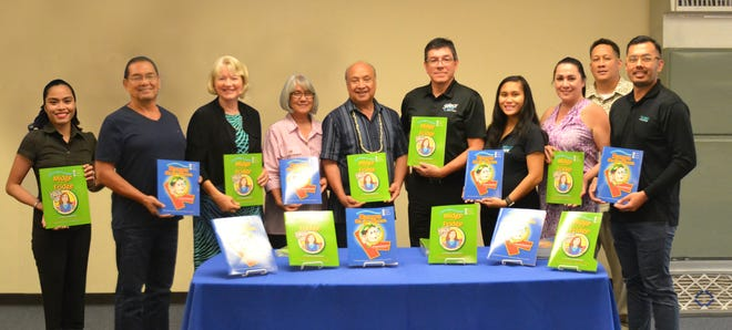Two locally-produced children's books, which promote healthy eating and regular exercise were officially presented to the Guam Public Library System on Oct. 10. They are the first of 1,000 sets which are to be given for free to young children in Guam in an effort to prevent childhood obesity. Author Frances Baumann and sponsor Frank Campillo, Calvo's SelectCare Health Plan administrator, presented 40 free books to Hagatna library technician supervisor Terry Kennimer and Johnny Sablan, president of the Dept. of Chamorro Affairs. Pictured from left: Graphic artist Stephanie Librando, illustrator Ariel Dimalanta, Baumann, Kennimer, Sablan, Campillo and wellness coordinator Christine Cruz and marketing representatives Zina Ada, Herman Ada and J. Saldana of Calvo's SelectCare.