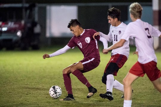 Henderson County's David Gonzalez (10) and Hopkins Central's Emiliano Sifuentes (11) battle during the boys soccer regional opener Monday in Madisonville. The Colonels won 10-0 and will face Trigg County in the semifinals on Wednesday.