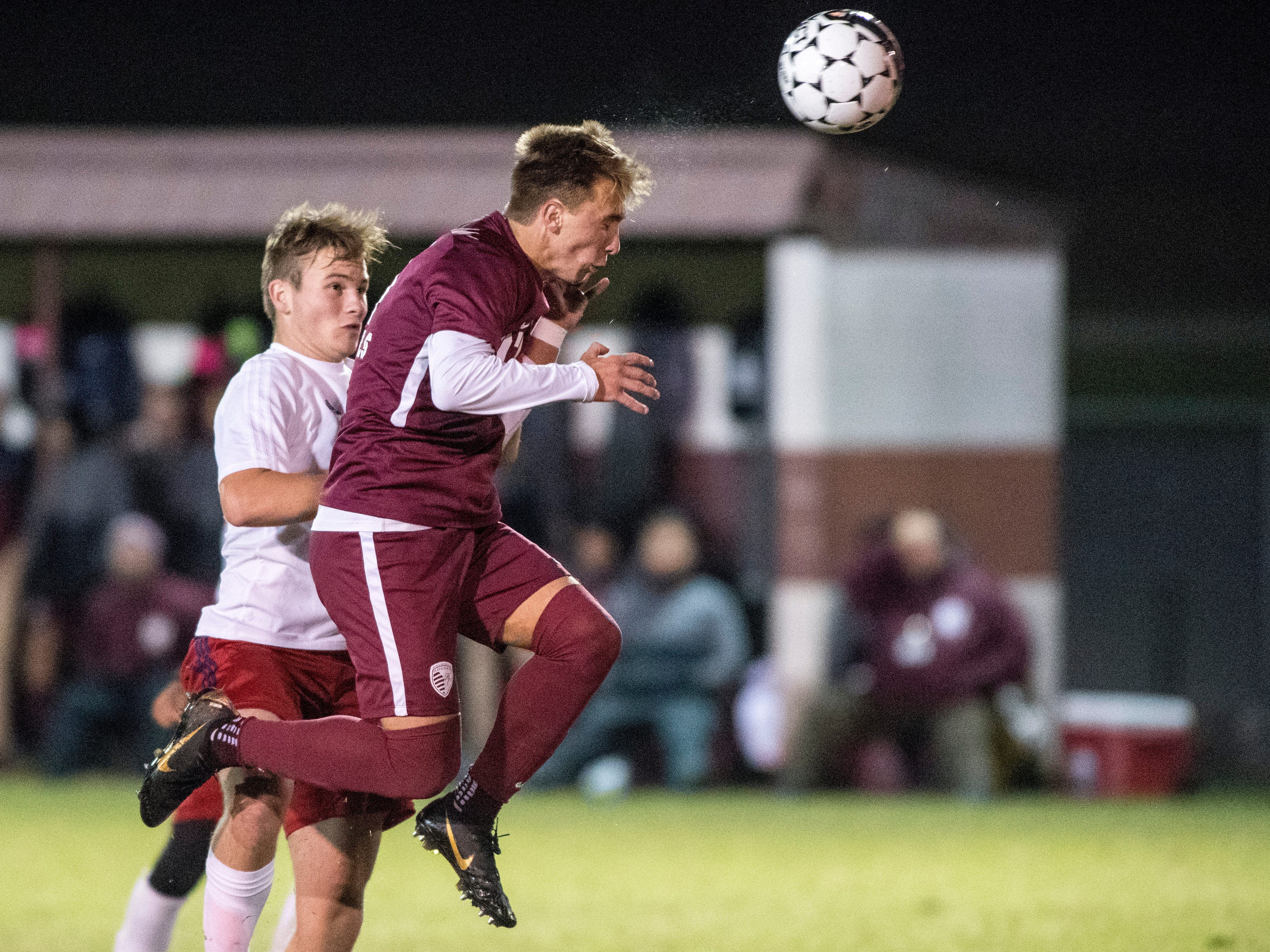 Henderson's Max Wawrin (11) heads the ball during the boys soccer regional opener against the Hopkins Central Storm Monday, Oct. 15, 2018. The Henderson Colonels won 10-0.