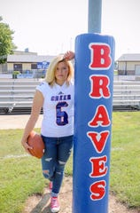 Hope Nelson is shown as a senior football player at Indian Creek High.