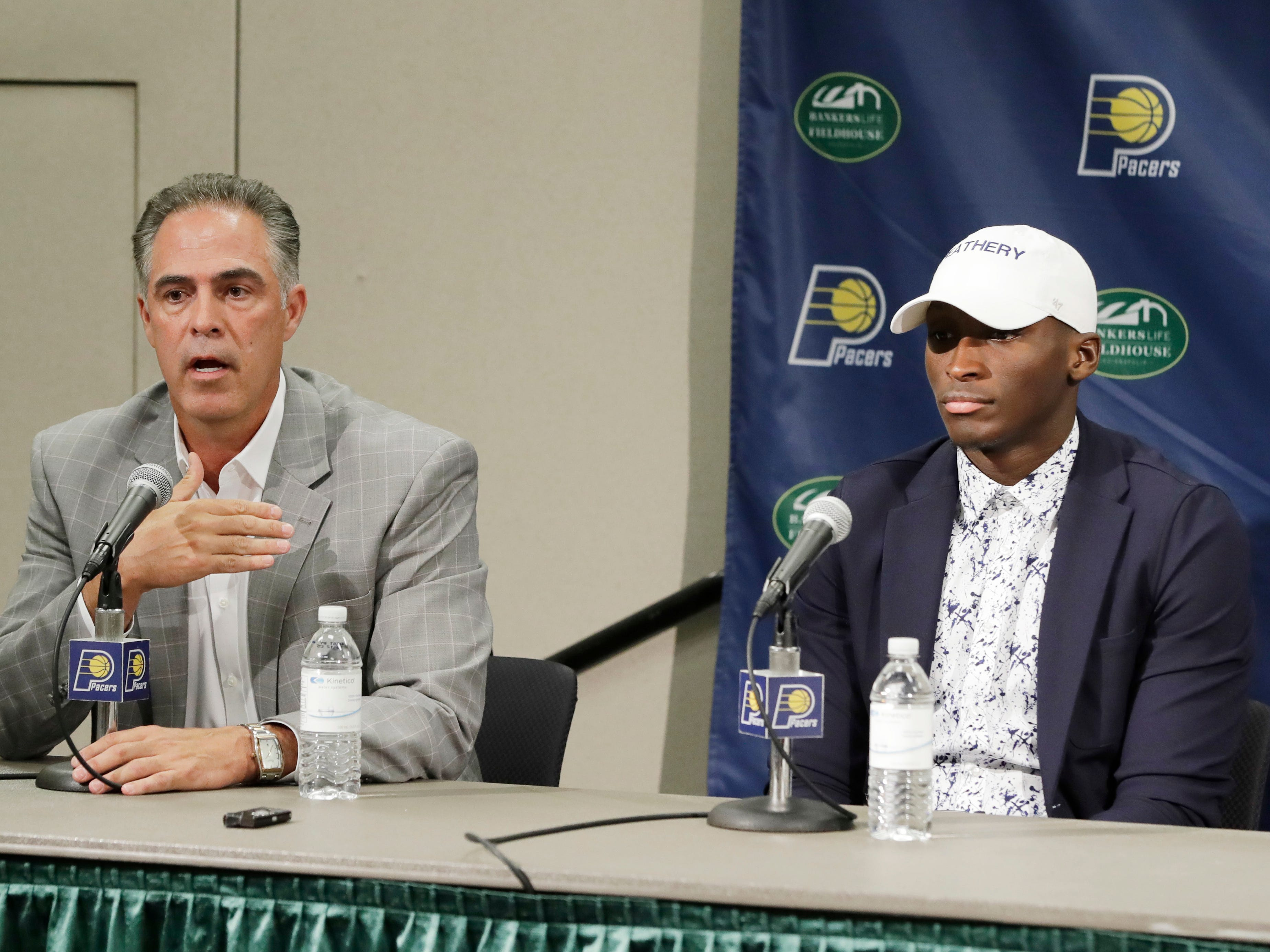 Indiana Pacers general manager Kevin Pritchard, left, speaks as Victor Oladipo listens during a news conference.