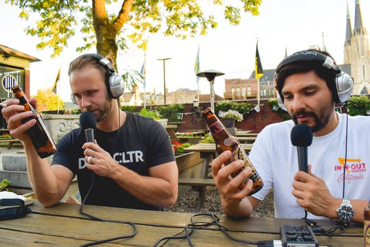 Jared Byczko, left, and Fabian Rodriguez record a recent episode of DRNK CLTR. Photo by Hayley Brown