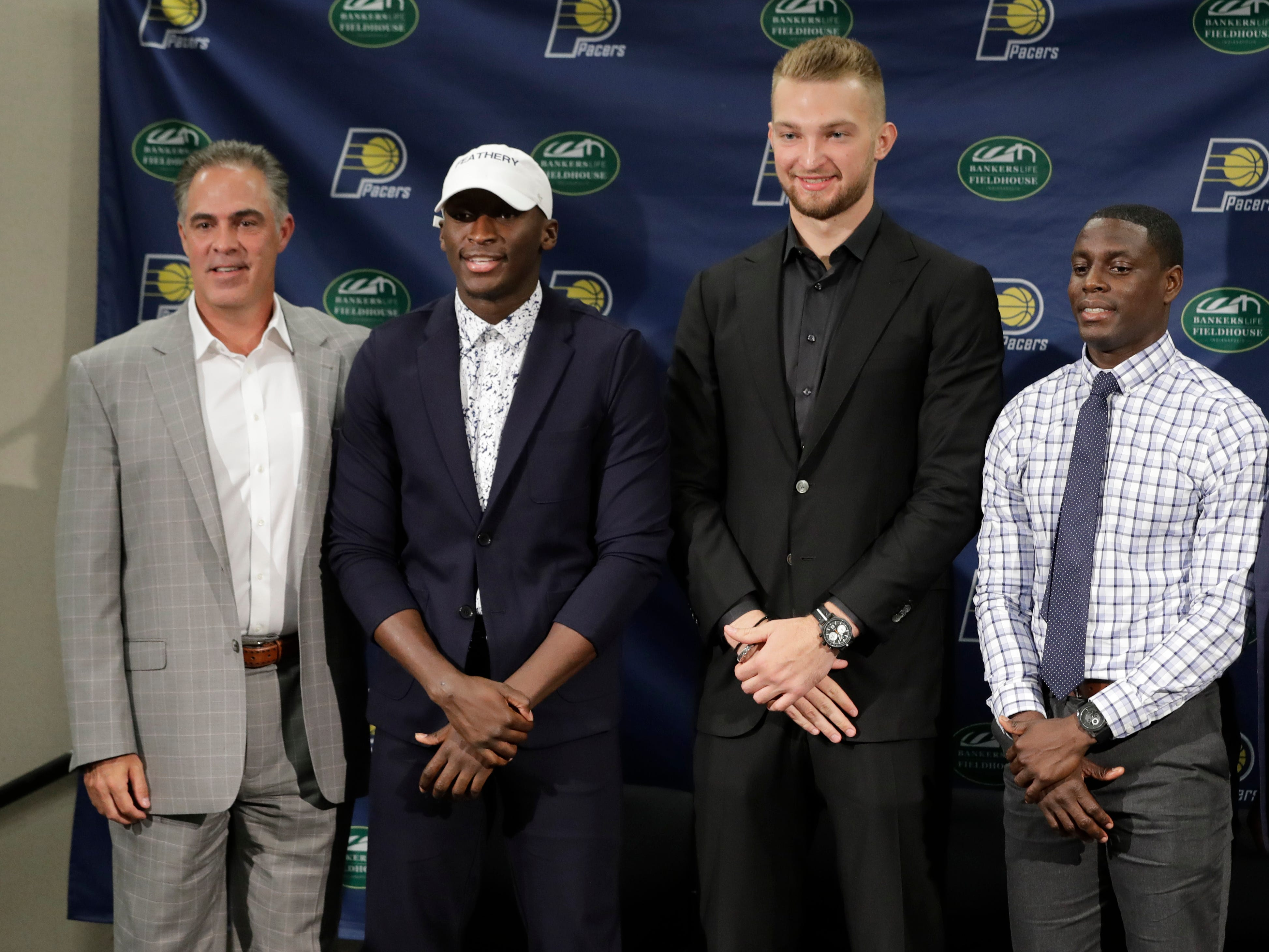 Indiana Pacers general manager Kevin Pritchard, Victor Oladipo, Domantas Sabonis, Darren Collison and head coach Nate McMillan, from left, pose for a photo during a news conference.