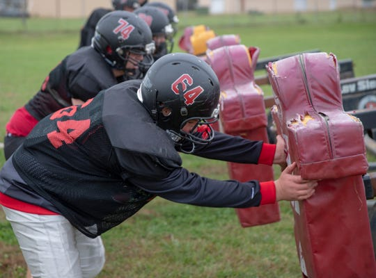 Kids work on a tackling sled on a recent afternoon that saw 21 kids suit up for practice at Edinburgh High School football practice, October 15, 2018. The team, winless on the year, has struggled as many small schools do, to find enough kids to field a team in the smallest Indiana division.