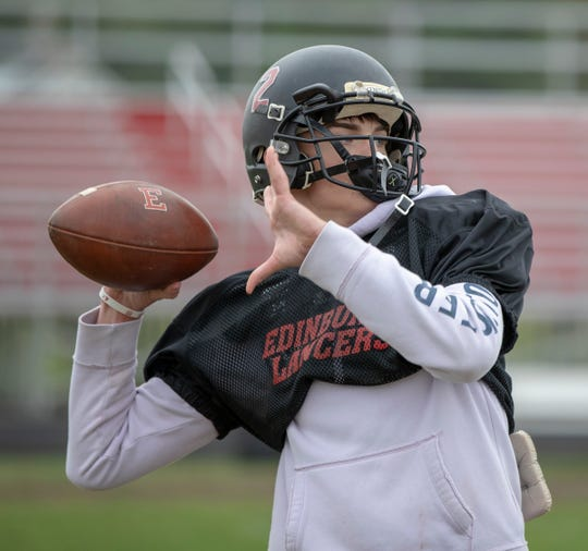 Tyson Sackman, 16, quarterback throws on a recent afternoon that saw 21 kids suit up for practice at Edinburgh High School football practice, October 15, 2018. The team, winless on the year, has struggled as many small schools do, to find enough kids to field a team in the smallest Indiana division.