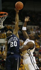 Butler's Brandon Polk rejected a first half shot by Joah Tucker, of UW-Milwaukee, on March 7, 2006.