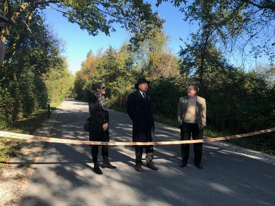 Anna Gremling with the Indianapolis Metropolitan Planning Organization (from left), Westfield Mayor, Andy Cook and Carmel Mayor, Jim Brainard prepare to cut the ribbon and open the last section of the Monon Trail in Westfield on Oct. 16, 2018.