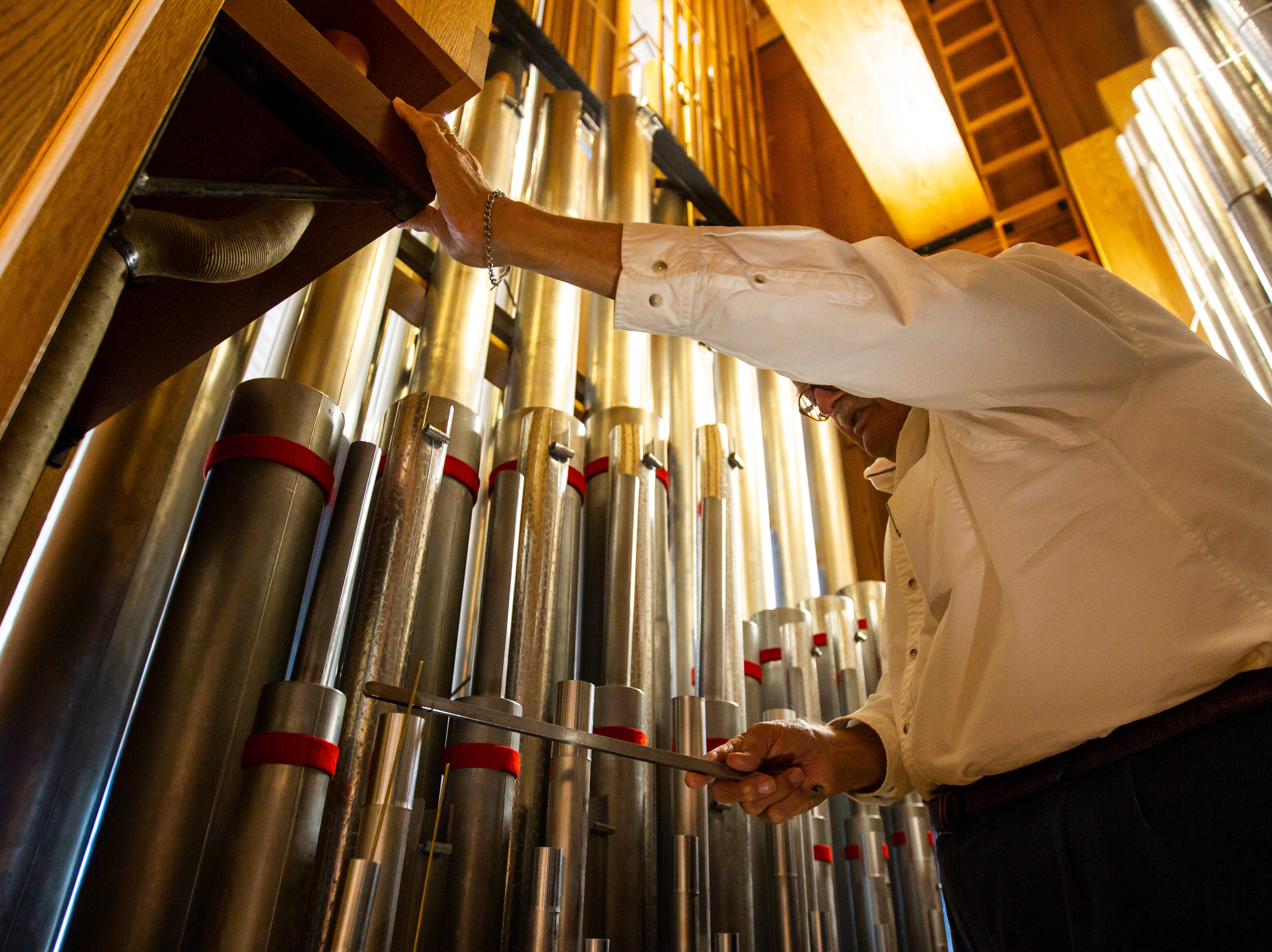 Carroll Hanson works to tune the pedal division of an organ on Tuesday, Oct. 16, 2018, at St. Andrew Presbyterian Church in Iowa City, Iowa. Hanson was in charge of tuning the organ while it was in Clapp Recital Hall before being moved to St. Andrew after the hall was flooded in 2008. Patrick Budelier now primarily works to maintain the organ at St. Andrew.