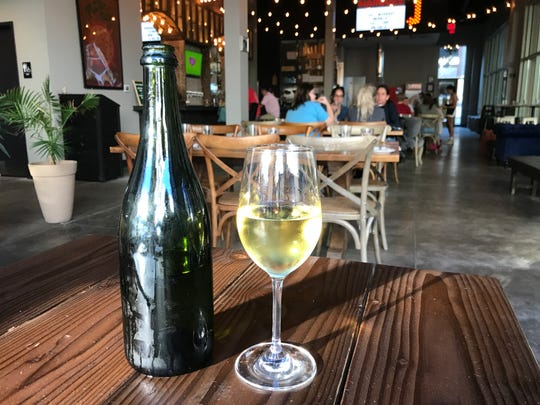 A bottle of wine inside Marquee Pizzeria in Coralville on Sept. 12, 2018.