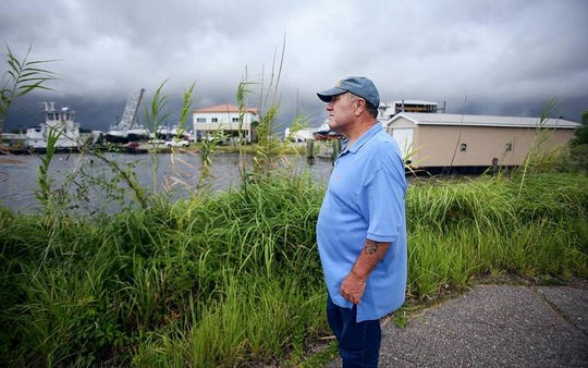 It's been 46 years since Charlie Hickson and Calvin Parker, pictured here overlooking the Pascagoula River, reported being abducted by aliens while fishing at the former Shaupeter Shipyard in Pascagoula on the Mississippi Gulf Coast. In 2018, Parker wrote a book about his experience. Since then, more witnesses have come forward.
