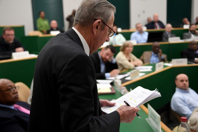 Madison County Commissioner Author Johnson Jr, makes a motion to vote on a $49.5 million jail expansion during a commission meeting, Monday, October 15. 18 commissioners voted yes, 6 voted no, and 1 passed.