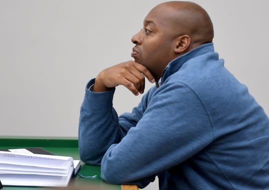 Jackson-Madison County Schools Superintendent Dr. Eric Jones listens in during the Madison County commission meeting on Oct. 15. Jones resigned Friday.