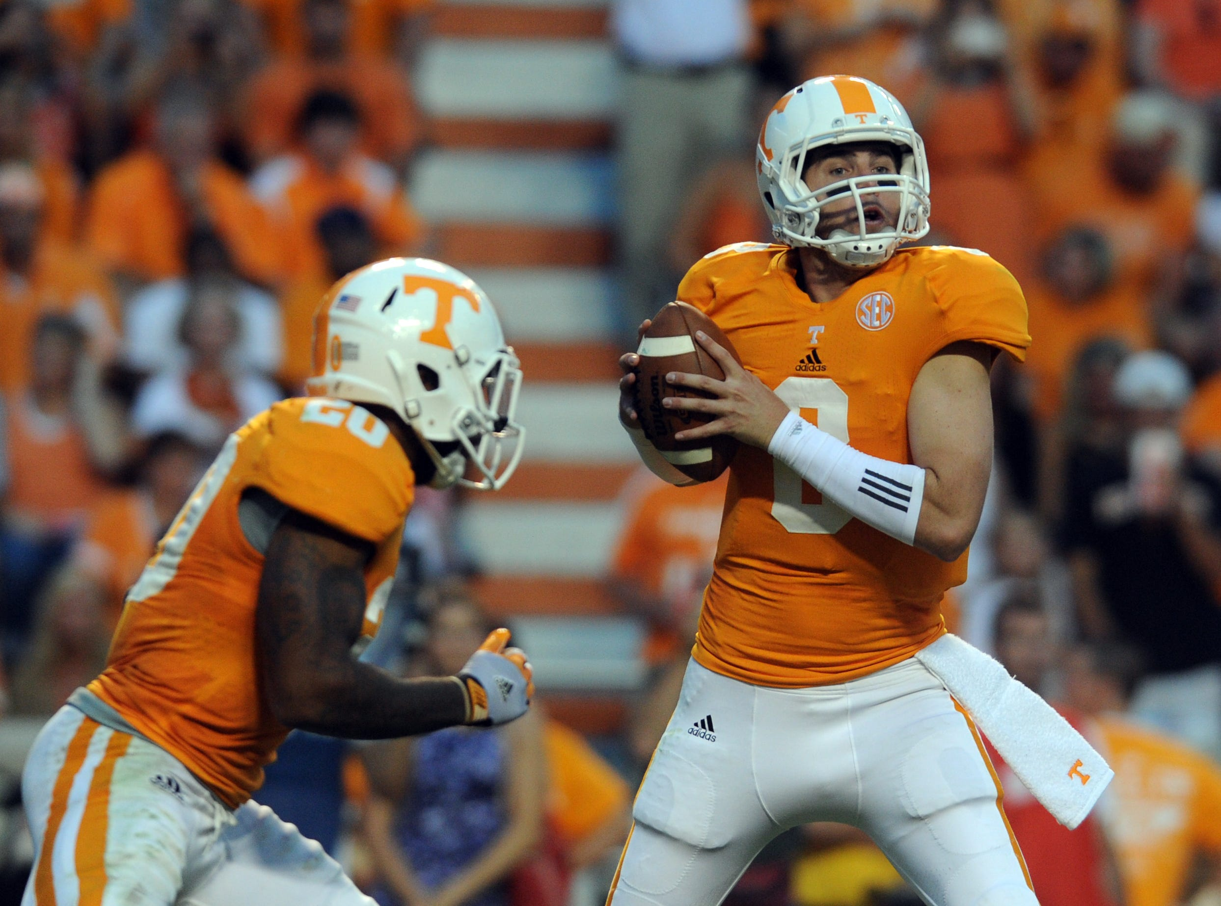 Tennessee quarterback Tyler Bray (8) fakes a handoff to tailback Rajion Neal (20) during the second quarter against Florida at Neyland Stadium Saturday, Sept. 15, 2012.