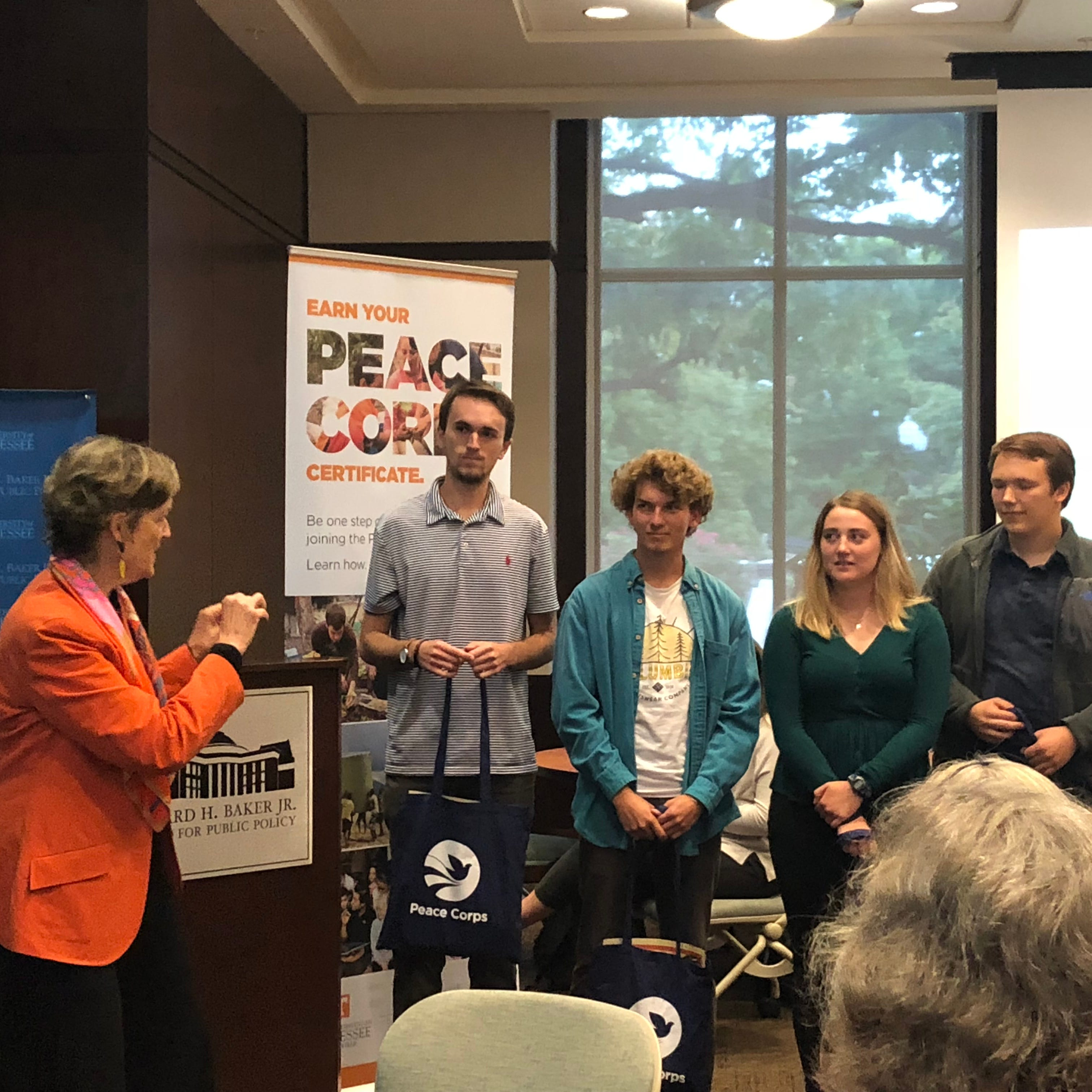 Peace Corps Director Judy Olsen, left, speaks to...