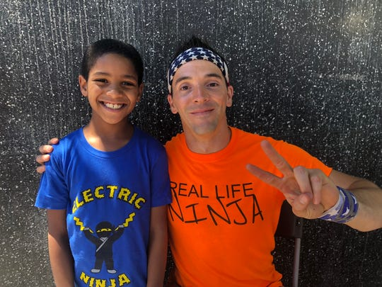 "Knoxville's Enoch Jones and ""American Ninja Warrior"" competitor Drew Drechsel pose for a photo together while Jones took part in the new show, ""American Ninja Warrior Junior."""
