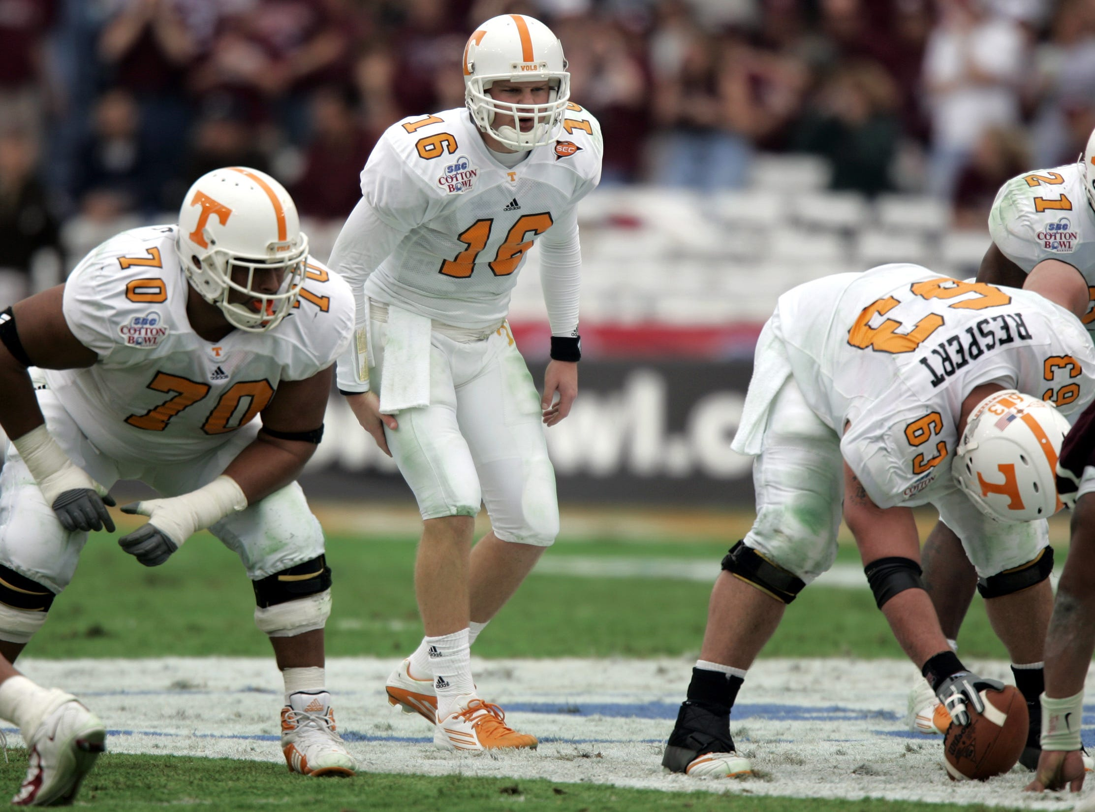 Offensive guard Cody Douglas, left, listens as  Tennessee quarterback Rick Clausen calls the play behind center Jason Respert in 2005.
