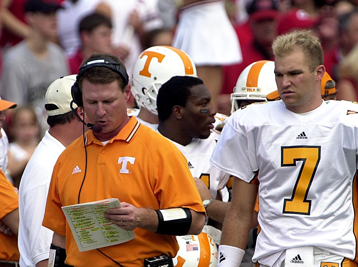 Tennessee offensive coach Randy Sanders looks over his call list with Casey Clausen waiting on the decision during the Georgia game in 2002.   Oct. 12, 2002