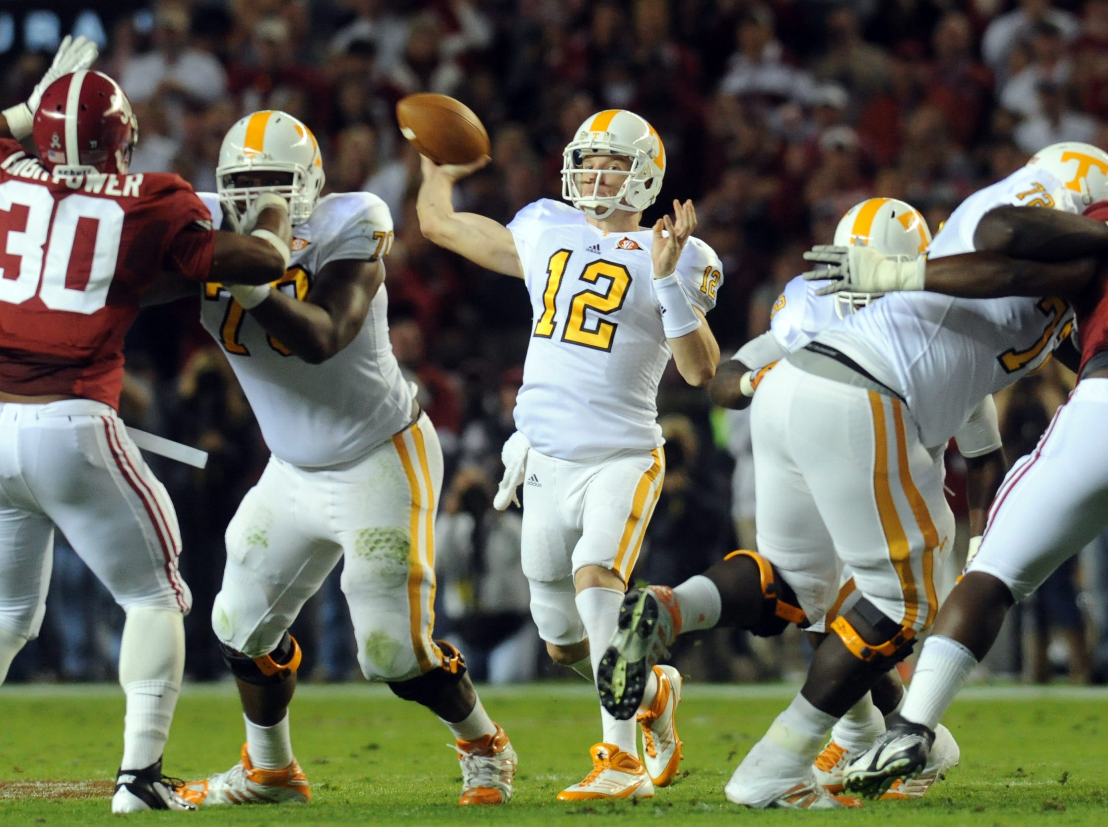 Tennessee quarterback Matt Simms (12) throws the ball during the game against Alabama at Bryant-Denny Stadium in Tuscaloosa, Ala., Saturday, Oct. 22, 2011.