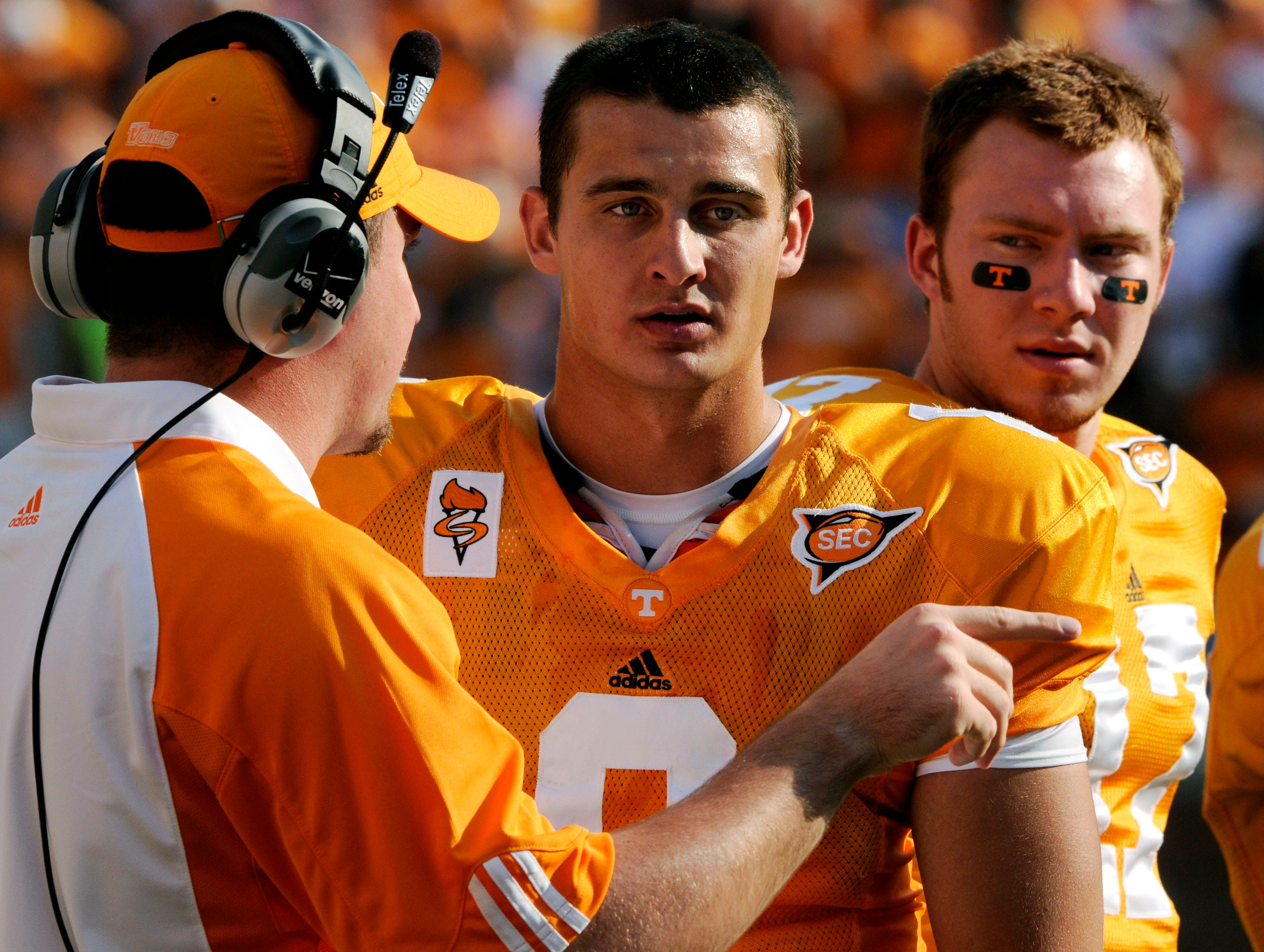 Tennessee quarterback Jonathan Crompton (8) listens to a coach and back-up quarterback Nick Stephens (17) in the background. Tennessee lost 30-6 to arch rival Florida in Neyland Stadium on September 20, 2008.