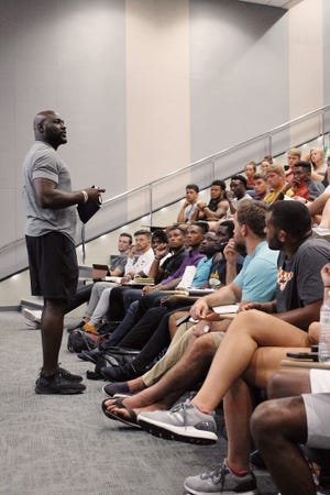 Former Vols football player Chris Walker, shown speaking to students at Chattanooga, now is the FCA campus director at Tennessee and a useful resource regarding coaching change.