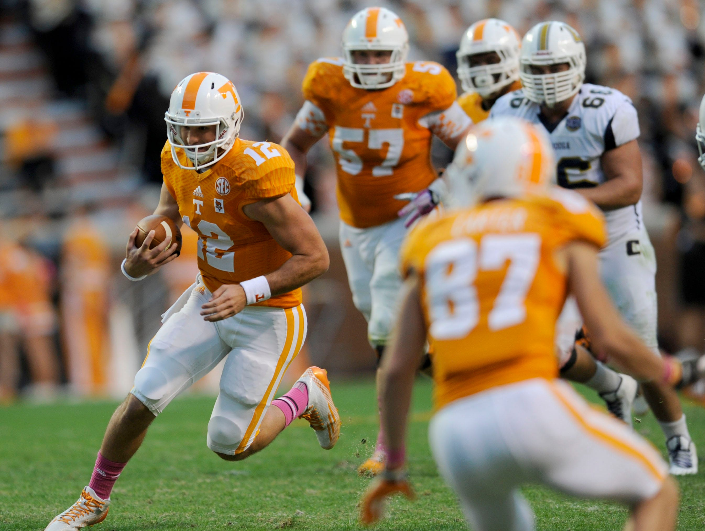 Tennessee quarterback Nathan Peterman (12) runs the ball during the second half at Neyland Stadium on Saturday, Oct. 11, 2014 in Knoxville, Tenn. Tennessee won the game 45-10.
