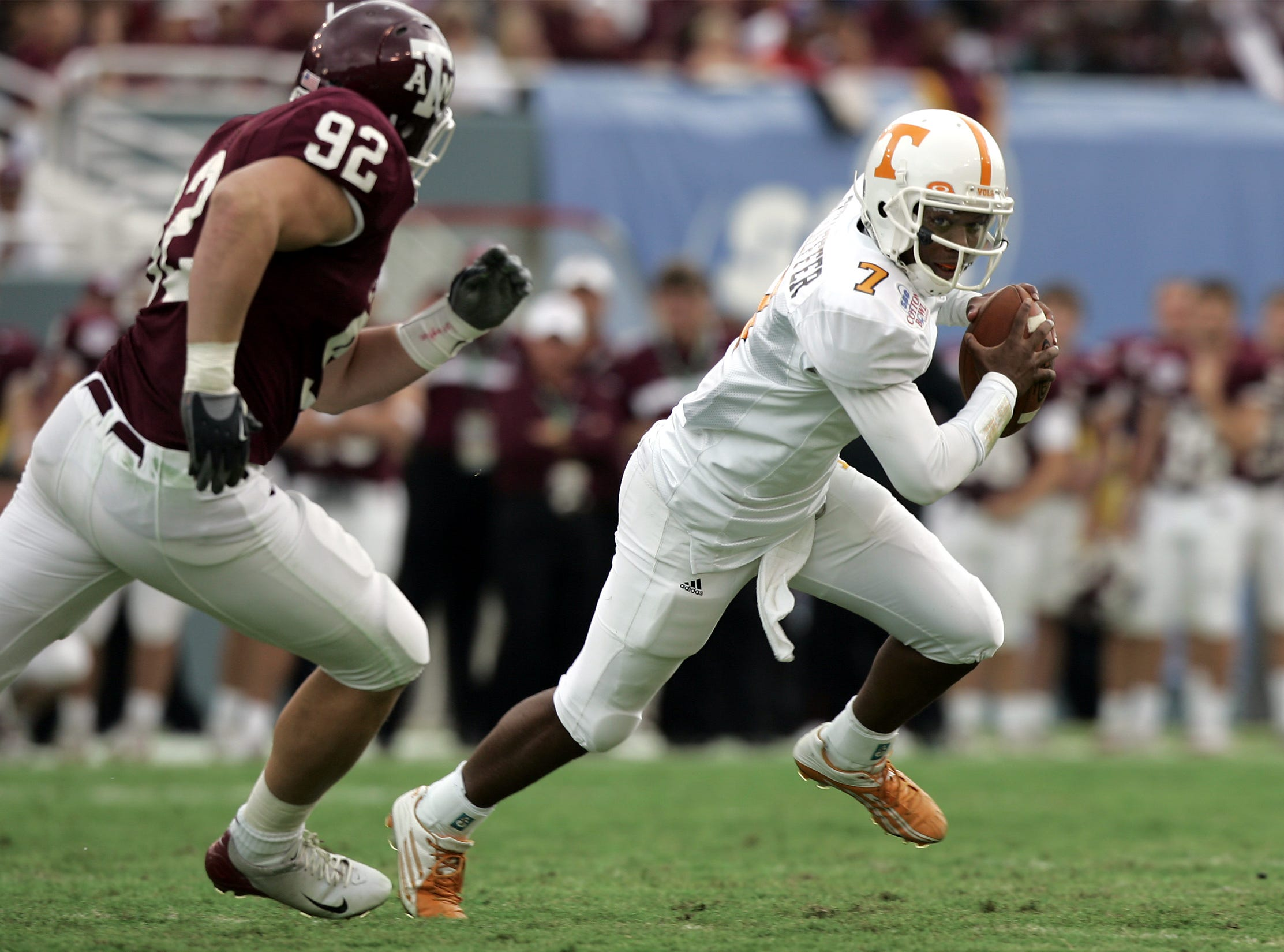 Tennessee's Brent Schaeffer runs out of the pocket as Texas A&M's Chris Harrington pursues during the Cotton Bowl on Jan. 1, 2005 in Dallas. The Vols won 38-7.