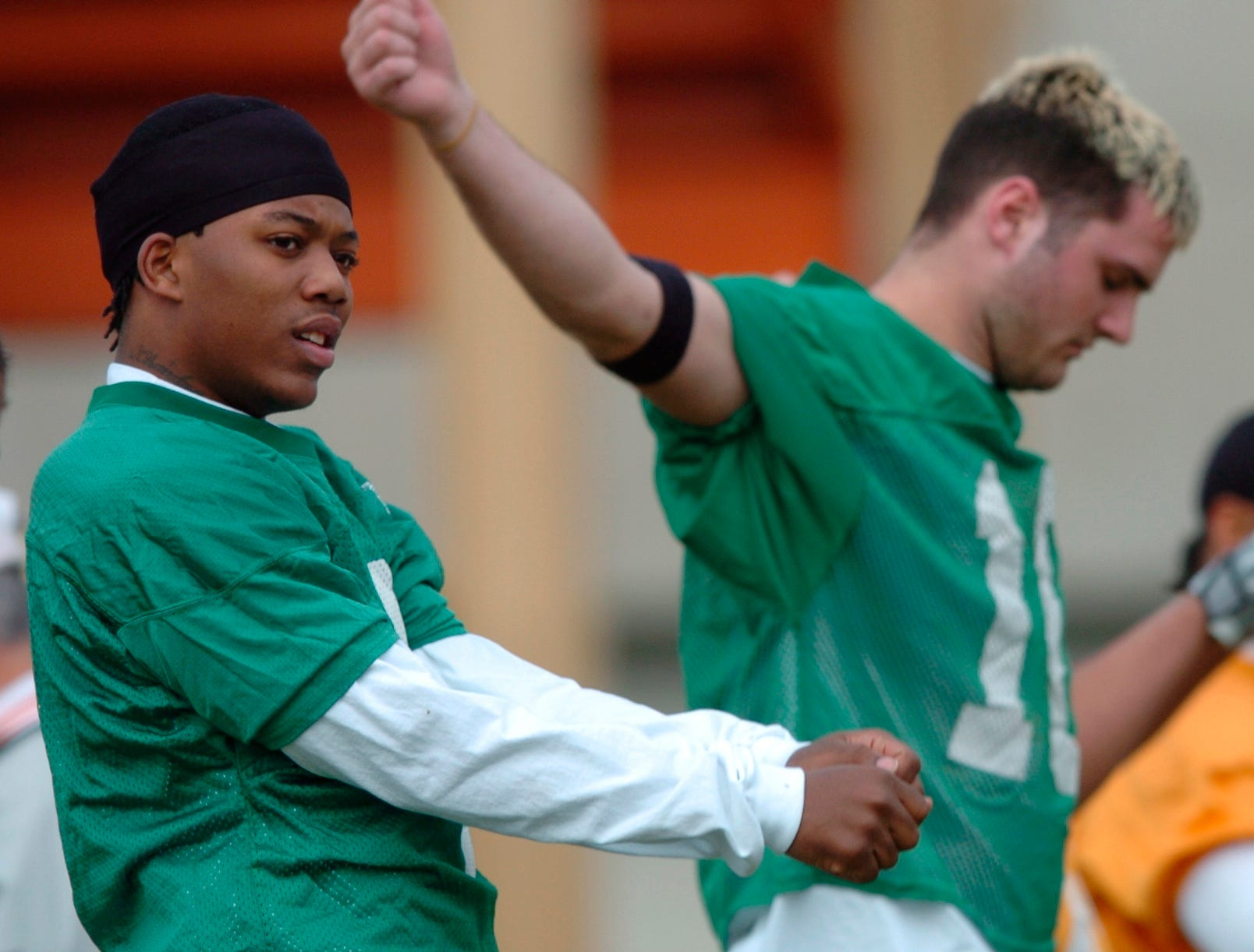 Tennessee quarterbacks Brent Schaeffer, left, and  Erik Ainge stretch during the Vols first spring practice Thursday afternoon on Haslam Field.-03/10/2005