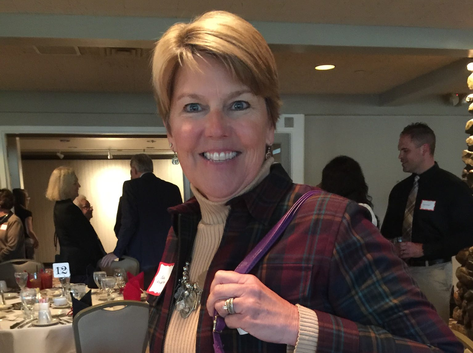 Cathy Wright-Eger, Leadership Advisor for Purdue Athletics, wore her purple purse at the Lafayette Country Club for the Jefferson High School Hall of Fame event.