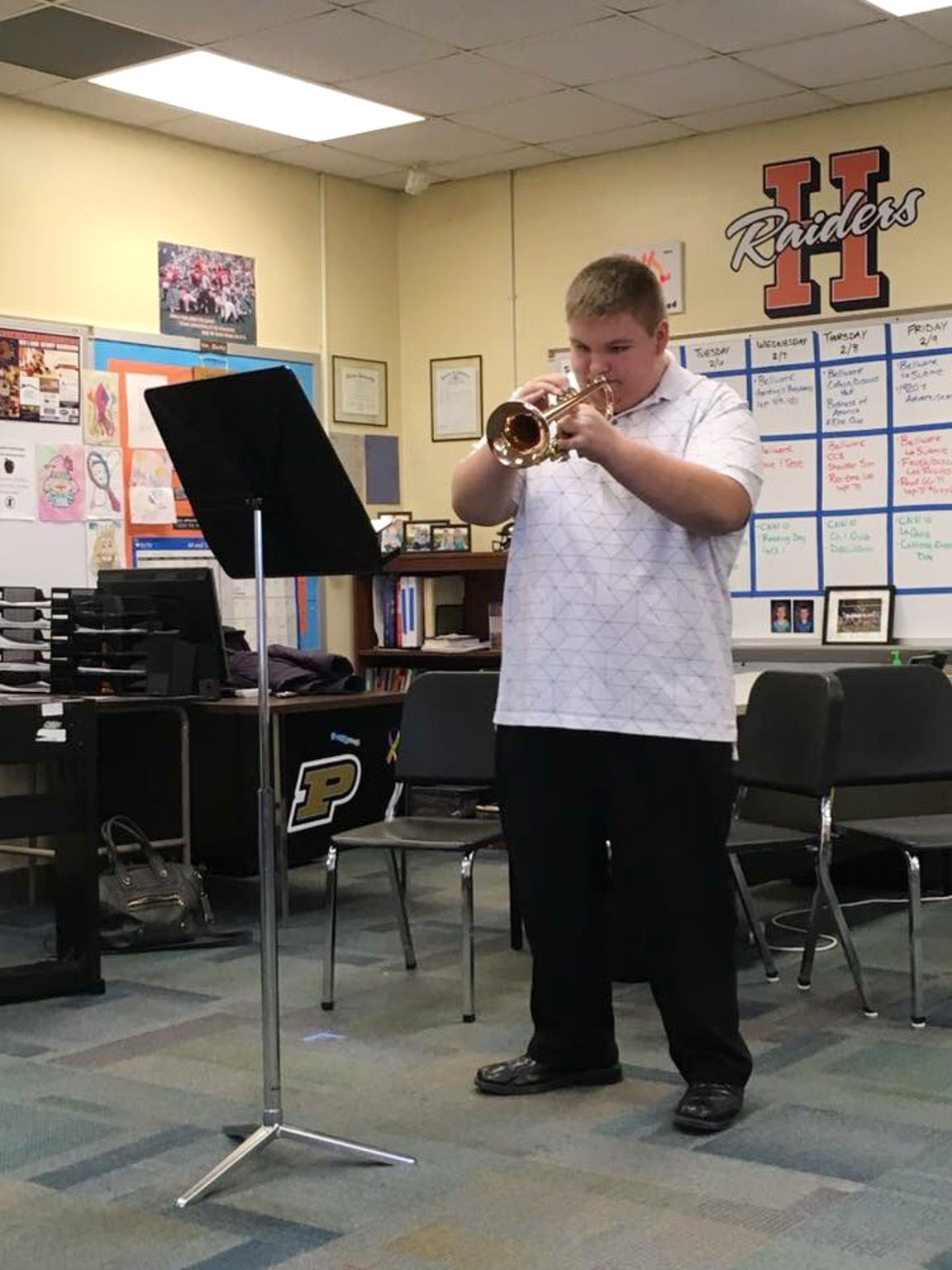 John playing his trumpet at District Solo and Ensemble, held at Harrison HS, 2018; Gold medal District and State.