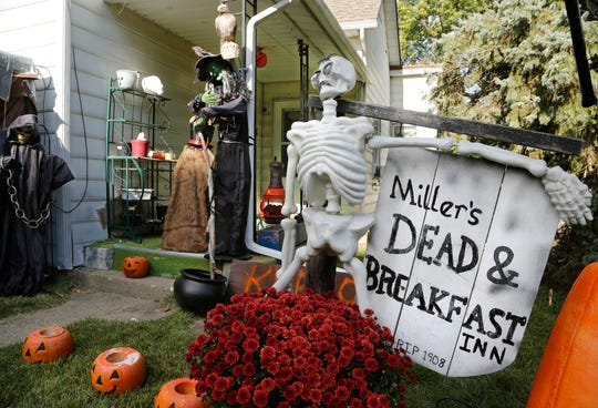 Halloween decorations cover the front yard of Ken and Connie Miller's home Tuesday, October 16, 2018, in the 2600 block of Main Street in Lafayette. The couple creates and personalizes most of the decorations by hand. The Dead & Breakfast Inn even has the real year the house was built.