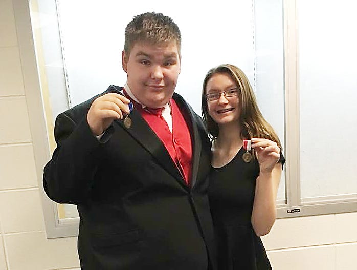 John and his sister Kayla holding their state gold medals from State Solo and Ensemble competition in Indianapolis, 2018.
