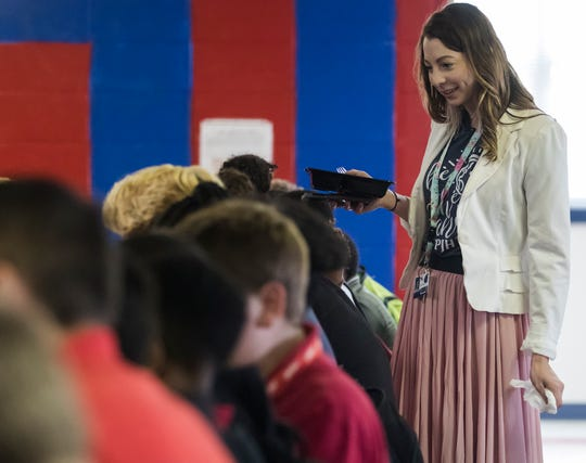 Amber Ball, 26, eats her lunch standing up and talking to students while on lunch duty at Caldwell Parish Junior High  in Columbia, La., proving teaching is a balancing act.
