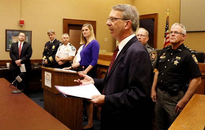 Fairfield County Common Pleas Court Judge Richard Berens talks before the beginning of a press conference Tuesday, Sept. 25, 2018, in Lancaster. Berens and other elected and appointed officials from throughout the county gathered to voice their opposition to Ohio Issue 1. Issue 1 would amend the Ohio constitution, would turn certain drug crimes into misdemeanors thus lessoning the penalties among other changes to the criminal justice