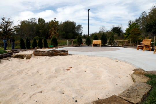 Sand pits are located next too a patio in the new outdoor education and play area at AHA! A Hands-On Adventure, A Children's Museum in Lancaster.