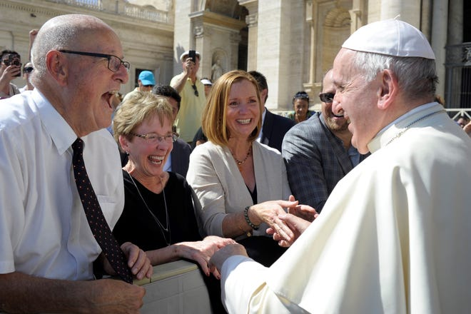 Allen and Kathy Ford of Howell, along with Angela and Jeremy Cohen, meet Pope Francis following a blessing at St. Peter's Square in Vatican City on Sept. 12, 2018.