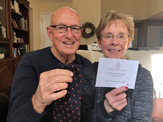 Allen and Kathy Ford of Howell with the tie Allen used to wipe the brow of Pope Francis, and the ticket with which they gained front row seats to a papal blessing at St. Peter's Square in Vatican City on Sept. 12, 2018.