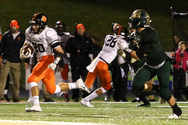 Running back Chris Seguin (20) and his Brighton teammates would host Lakeland in the first round if the state football playoffs began this week.